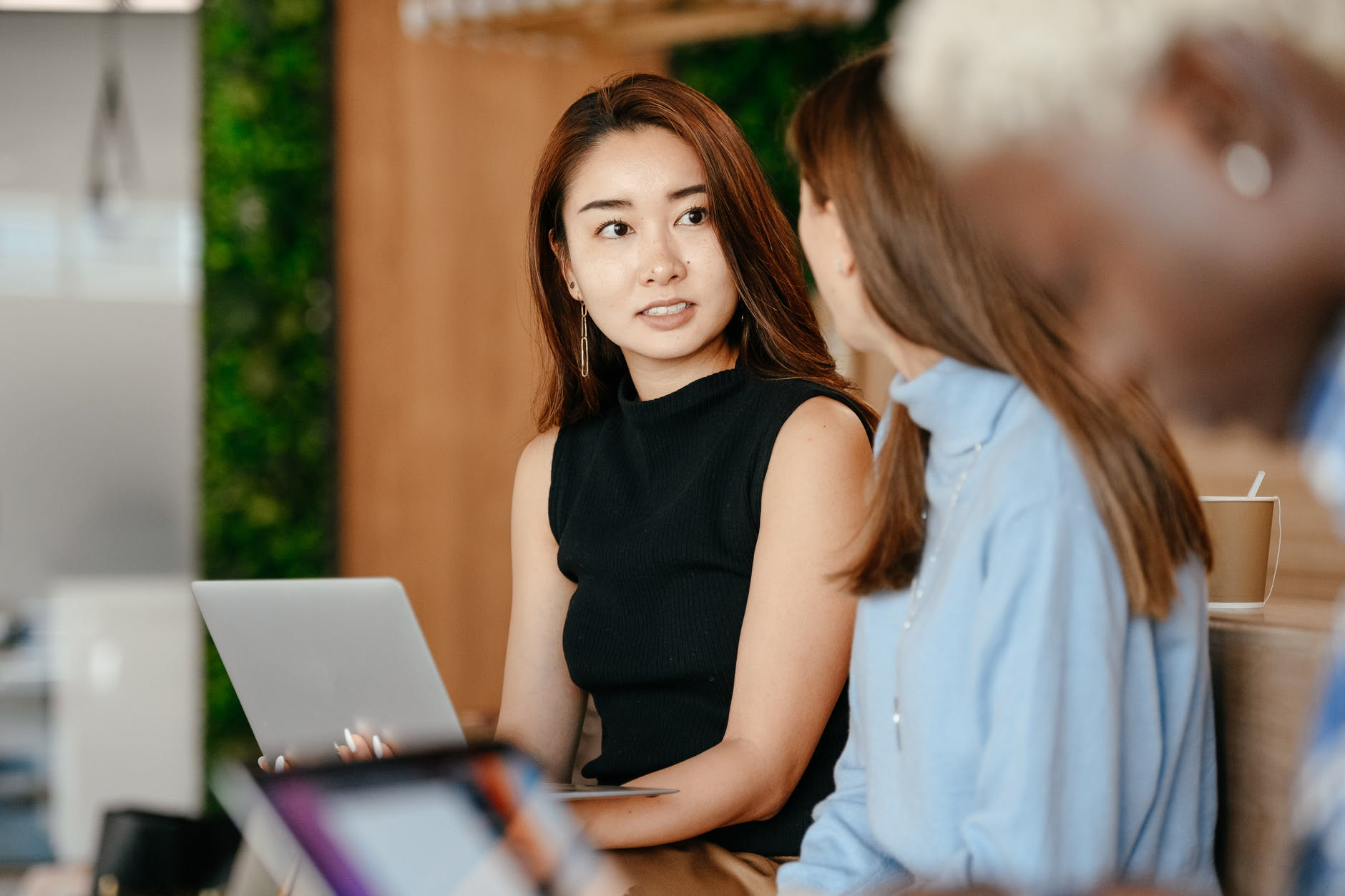 asian woman discussing career plan with diverse colleagues