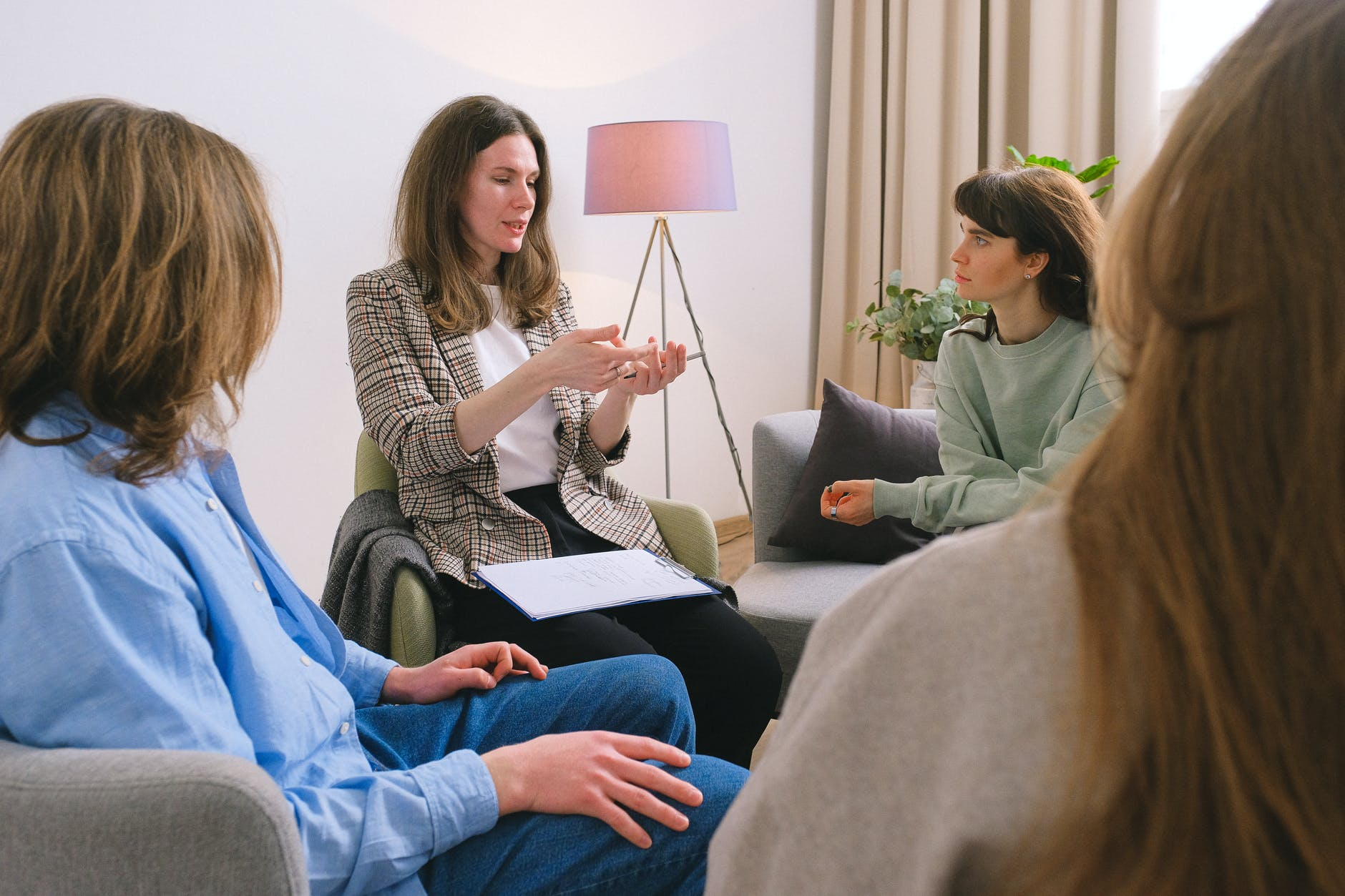 female specialist speaking to group of clients